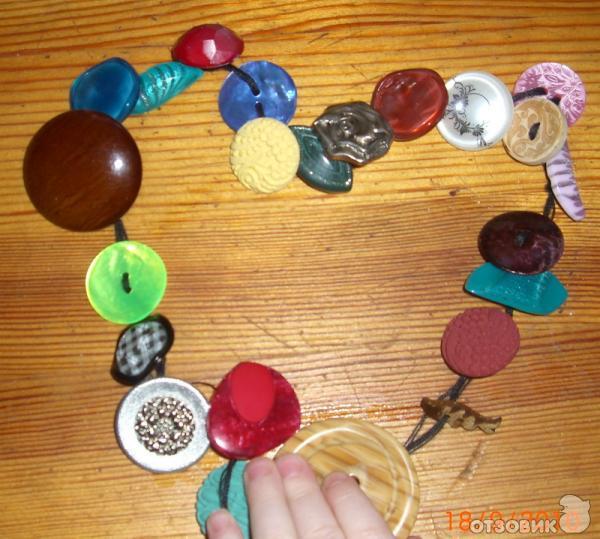Игрушка для ребенка из пуговиц своими руками